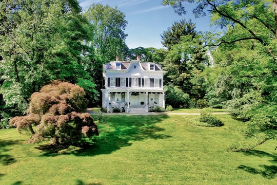 Treetops, a white victorian home located nine acres at the end of a long tree-lined lane in Sparkill, New York