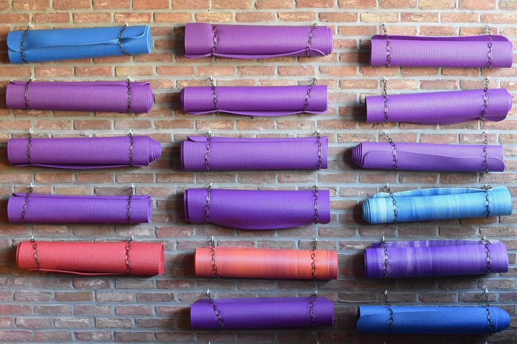 colorful yoga mats on wall at Birchwood Center Yoga & Massage, Nyack, New York