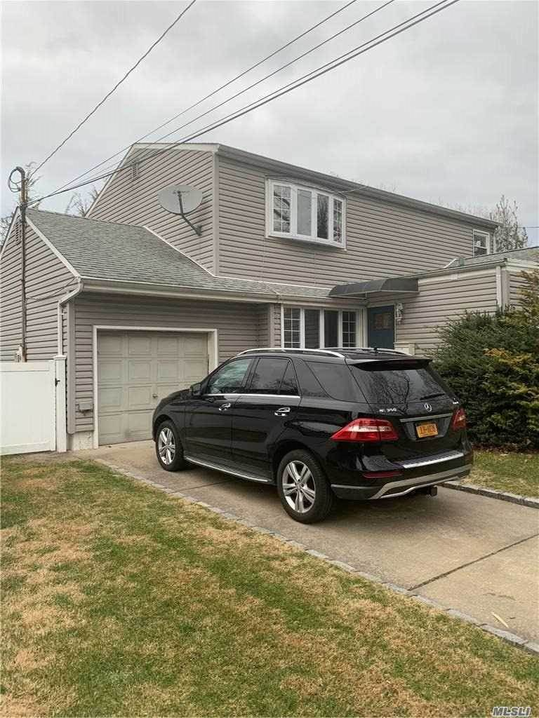 Residential for Sale at 196 Woods Avenue, Malverne, NY 11565 Malverne, New York 11565 United States