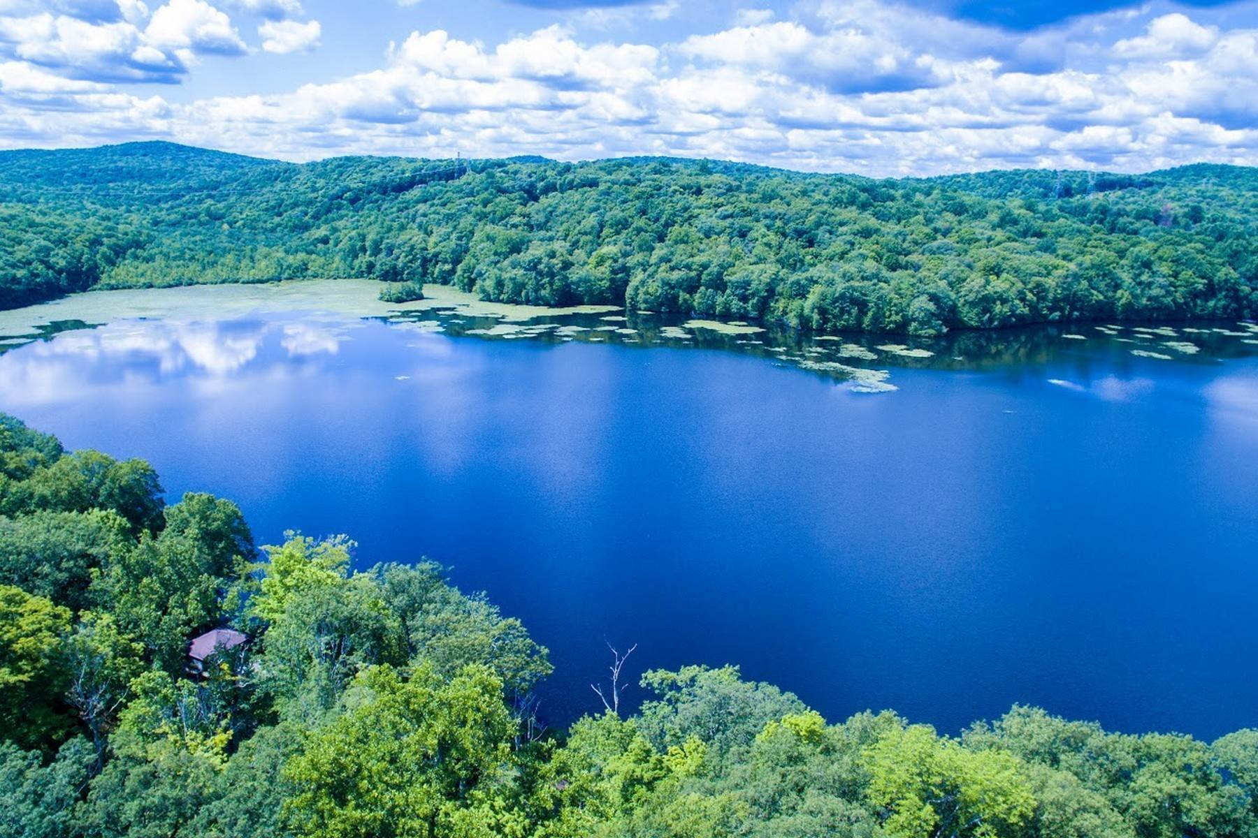 32. Single Family Homes for Sale at Exclusive Waterfront Home 4 Old Cranberry Road Pierson Lakes, New York 10974 United States